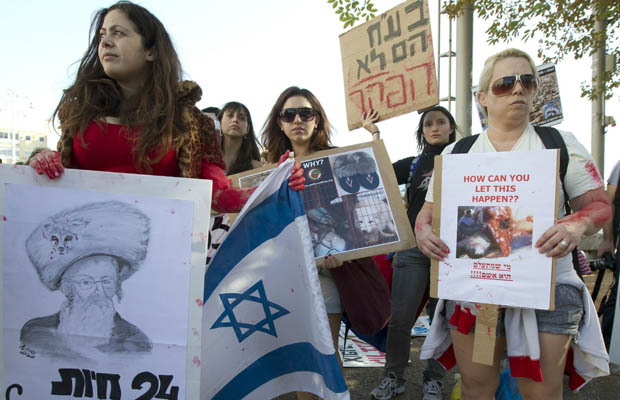 Israeli anti-fur activists protest during a national rally against the exploitation of fur called by Worldwide Fur Free Friday, an animal protection association, on November 26, 2010 in Tel Aviv.
