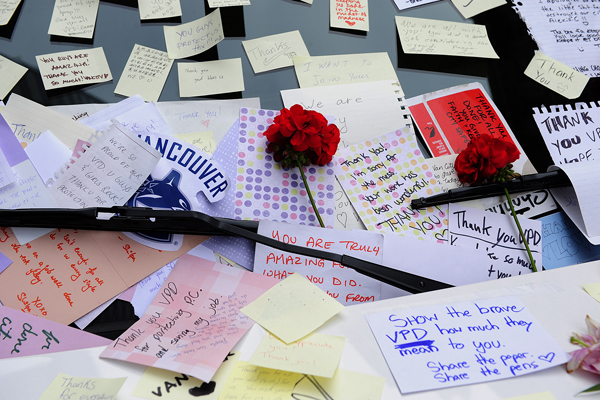 Vancouver residents place messages of support on a police cruiser on Granville St following the riot after the Canucks Stanley defeat by thye Boston Bruins, in Vancouver, BC., on June 17, 2011.