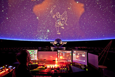 David Bush worked the console of the planetarium's projection system, showing Orion. (Photo credit: Michael Kirby Smith for the New York Times)