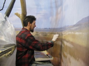 Sean Murtha creates a new backgorund painting of the African savanna