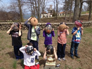 Kids show masks they made at the Vanderbilt
