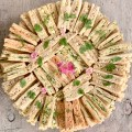 Finger Sandwich options served on a gorgeous large platter with fresh flowers