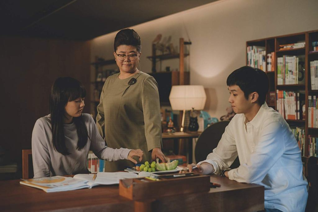 Woo-sik Choi, Jeong-eun Lee, and Ji-so Jung in Parasite. Recent film releases you should watch.