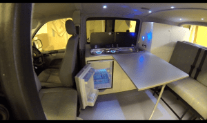 VW Camper with a great kitchen... Fridge and Freezer, Two Burner Hob Running Water and a Table to eat your meals from... :)