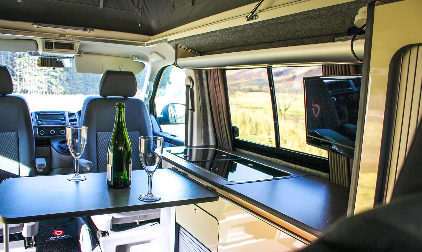 VW T5 Highline Campervan Conversion with sliding table and CAN hob fitted with T.V.