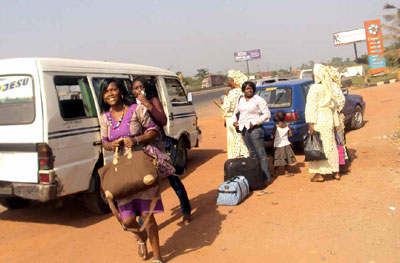 Ladies arriveding from Lagos with expectations that All Will Be Well.