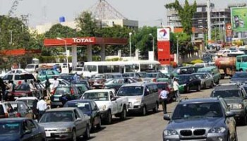 Image result for Long queues surface in Petrol stations in Abuja