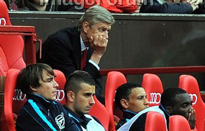 Arsenal's French manager Arsene Wenger looks on during the match . Photo: AFP.