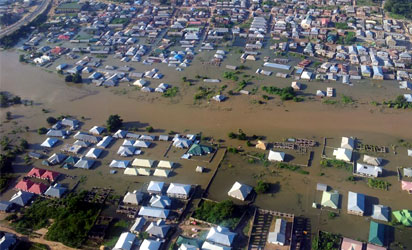 File photo: Areal view of Lokoja, Kogi State...under  the siege of flood