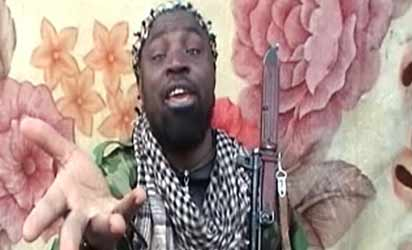 File: A video grab made on March 21, 2013 from a video distributed to reporters by purported intermediaries of the Islamist group linked to Al-Qaeda, Boko Haram,  shows the suspected leader of the Nigerian Islamist group linked to Al-Qaeda, Boko Haram, Imam Abu Muhammad Ibn Muhammad Abubakar Ash Shekawi, also known as Abubakar Shekau, at an undisclosed location in Nigeria. AFP