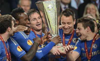 Chelsea's players celebrate with their trophy at the end of the UEFA Europa League final football match between Benfica and Chelsea on May 15, 2013 at Amsterdam Arena in Amsterdam. Chelsea won 2-1.  AFP .