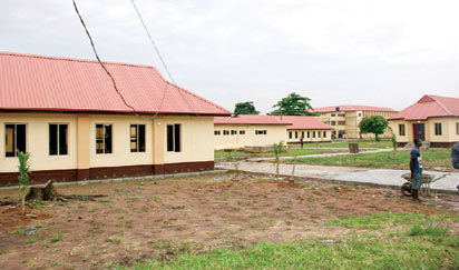 *New looks: Some of the renovated buildings. Inset: President Goodluck Jonathan and Police college commandant, Irimiya Yerima  inspecting the sorry state of the college during  the unscheduled visit.