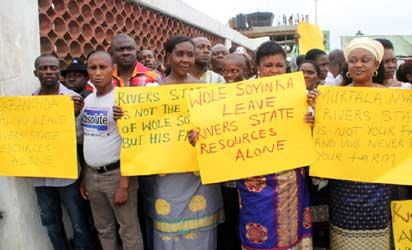PROTEST: Some members of Grassroots Development Initiative, GDI, protesting at the Omagwa International Airport, Rivers State against the visit of some Northern governors to Port Harcourt, yesterday Photo: Nwankpa Chijioke.