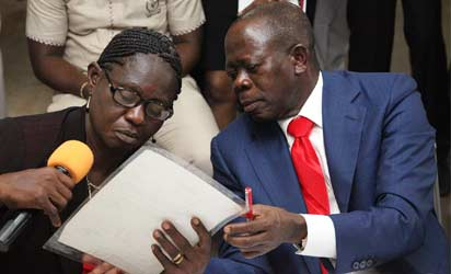 Oshiomhole and one of the state's  teacher