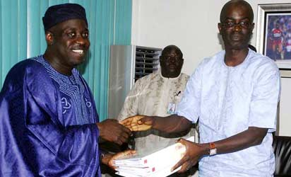 PRESENTATION: Chairman of the ministerial panel on Super Eagles bonus row, Segun Adeniyi (r) presents  the report of their findings to Sports Minister, Bolaji Abdullahi in Abuja Thursday. Photo Gbemiga Olamikan