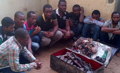 The Ikeja airport robbery gang with their box of rifles and charms