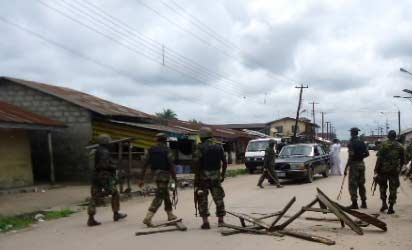 Military men on the streets of Kokori, Delta State, after Kelvin's arrest