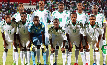 : Players of Nigeria pose for a team photo prior to the FIFA U-17 World Cup UAE 2013 Semi Final match between Sweden and Nigeria at Al Rashid Stadium