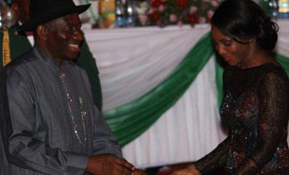 President Goodluck Jonathan presenting  a National Award to  a recipient