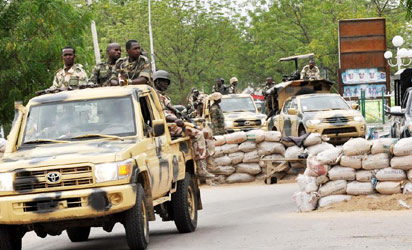 SOLDIERS ON GUARD ON POST OFFICE ROAD IN MAIDUGURI
