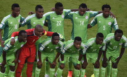 BRAZIL, Curitiba : (From top L) Nigeria's team midfielder John Obi Mikel, forward Emmanuel Emenike, defender Kenneth Omeruo, defender Godfrey Oboabona and defender Efe Ambrose (from bottom L) forward Victor Moses, goalkeeper and captain Vincent Enyeama, forward Ahmed Musa, midfielder Ogenyi Onazi, midfielder Ramon Azeez and defender Juwon Oshaniwa pose during a Group F football match between Iran and Nigeria at the Baixada Arena in Curitiba at the 2014 FIFA World Cup on June 16, 2014. AFP PHOTO