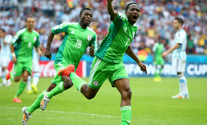 - JUNE 25: Ahmed Musa of Nigeria celebrates scoring his team's second goal during the 2014 FIFA World Cup Brazil Group F match between Nigeria and Argentina at Estadio Beira-Rio on June 25, 2014 in Porto Alegre, Brazi