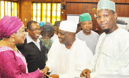 Speaker Aminu Tambuwal (m) With others during an emergency plenary In Abuja on Thursday (20/11/14).