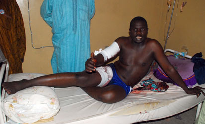 A man speaks on his hospital bed on November 25, 2014 about injuries sustained following double female suicide bomb attacks that killed 45 people in Maiduguri, northeastern Nigeria.  More than 45 people were killed when two female suicide bombers blew themselves up in a crowded market in northeast Maiduguri