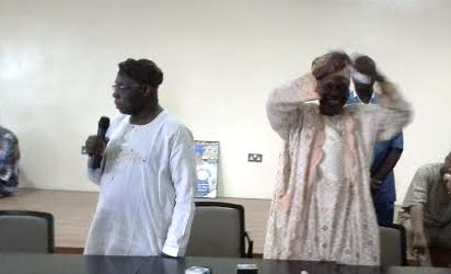 OBASANJO—Ex-President Obasanjo (left) watches as Alhaji Usman Oladunjoye tears the PDP membership card. Right: Obasanjo's card after it was torn, yesterday.