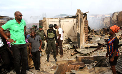 Ekiti State Governor, Mr. Ayodele Fayose, inspects the Oja Oba market in Ado-Ekiti  torched  hoodlums on Friday