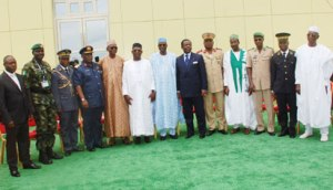MEETING: Permanent Secretary, Ministry of Defence, Alhaji Ismaila Aliyu (middle); Chief of Defence Staff, Air Chief Marshal Alex Badeh (4th left); Executive Secretary, Lake Chad Basin Commission, Mr Sanusi Abdullahi (4th right) and Chief of Defence Staff of Chad, Lt.- Gen.  Brahim Mahamat (5th right) and other Ministers of Defence and Chiefs of Defence of the Lake Chad Basin Commission's Member Countries and Benin Republic, at a meeting in Abuja, yesterday. Photo: Nan.