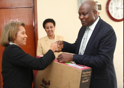 photos of the presentation ceremony. Middle, Illiyasu Kwarbai, receiving the equipment from from Dehab Ghereab.