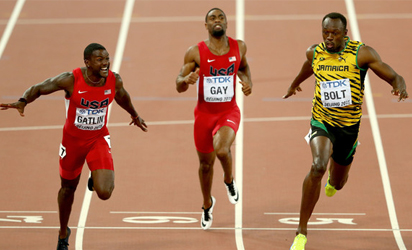 CHAMPION.....Usain Bolt wins gold in the men's 100m final as Justin Gatlin of the USA wins silver at the IAAF World Athletics Championships in Beijing on August 23.