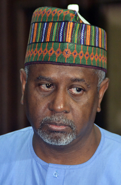 """Former national security adviser of ex-president Goodluck Jonathan, Sambo Dasuki (R), speaks with his lawyer Ahmed Raji, during his trial at the federal high court in Abuja, on September 1, 2015. Nigerian prosecutors on September 1, 2015 slapped a charge of unlawful possession of arms against Dasuki. Dasuki was arraigned on a """"one-count charge of being in possession of firearms without licence,"""" Prosecutor Mohammed Diri told the federal high court in Abuja. AFP PHOTO"""