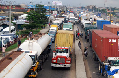 hellish time back again: Fuel tankers and container-laden trucks along Funsho William Avenue, Lagos, triggering a traffic snarl that lasted for several hours, yesterday. Photo by Joe Akintola, Photo Editor.