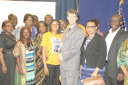 Joe Odumakin (middle) and others at an event.