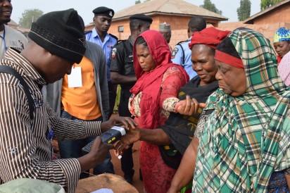 PIC. 2. WOMEN BEING ACCREDITED FOR SUPPLEMENTARY GOVERNORSHIP EL ECTION, AT OFEJIKPI 2, POLLING UNIT 022 IN ANYIGBA, DEKINA LGA OF KOGI ON SATURDAY (5/12/15).