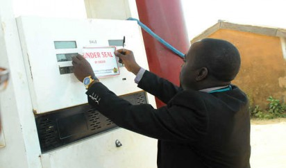 File photo: DPR official sealing a fuel station