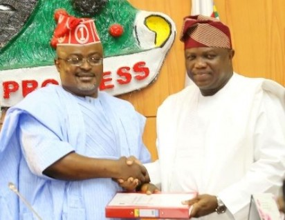 Lagos State Governor, Mr. Akinwunmi Ambode (right), presenting the 2016 Budget to the Speaker, Lagos House of Assembly, Rt. Hon. Mudashiru Obasa