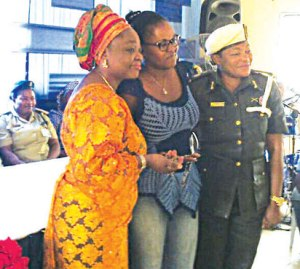 From L-R: Hon Lola Akande, the Lagos State Commissioner for Women Affairs and Poverty  Alleviation, an inmate who presented a beautiful neck bead to the Commissioner and the Deputy Controller of Prisons in charge of the female prison, Mrs. Ekpendu M. Lizzie