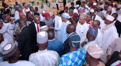 President Muhammadu Buhari exchanges greeting with Hon Kingsley Sunday Ebenyi and other national assembly members after the presidential dinner at the Presidential Villa. PHOTO; SUNDAY AGHAEZE/STATE HOUSE. MAY 31 2016