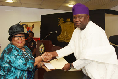 PIX 7985: Lagos State Governor, Mr. Akinwunmi Ambode (right), congratulating the new Chairman, Lagos State Independent Electoral Commission (LASIEC), Justice Ayotunde Philips, Rtd. (left) during her swearing-in at the Conference Room, Lagos House, Ikeja, on Wednesday, June 29, 2016.