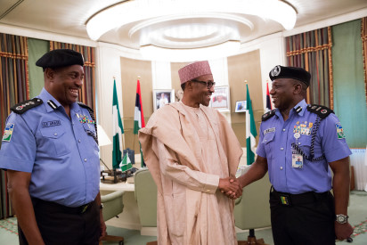 President Buhari with L-R Outgoing Inspector General of Police Solomon Arase, New Acting Inspector General of Police Mr Ibrahim Kpotun Idris and Chief of Staff to the President Abba Kyari as President Buhari congratulates New Acting Inspector General of Police Mr Ibrahim Kpotun Idris in Statehouse on 21st June 2016