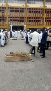 The OAU workers as they stormed the university with a mock casket
