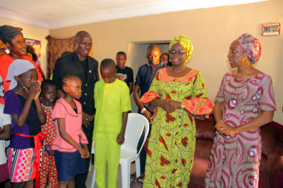 -Dolapo Osinbajo , Wife of Vice President  (right) , Pastor Olawale Elisha (middle), husband of (Late Eunice Olawale ) who was murdered in her cold blood on Saturday Morning while preaching at Kubwa in Abuja  during a condolence visit to the family on Sunday .