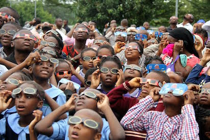 Students from various schools observe the annular solar eclipse at National Space Research and Development Agency (NSRDA) in Abuja on Thursday . Photo by Gbemiga Olamikan