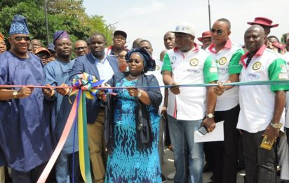 Lagos State Deputy Governor, Dr. (Mrs.) Oluranti Adebule (middle), cutting the tape to commission the Slip Road in Alapere, Ketu, being supported by member, Lagos State House of Assembly, Hon. Tunde Buraimoh (left); Chairman, House Committee on Transportation, Hon. Mojeed Fatai; Managing Director, Planet Project Limited, Mr. Biodun Otunola (3rd left); Special Adviser to the Governor on Transportation, Prince Anofi Elegushi (3rd right); his counterpart for Food Security, Mr. Ganiu Okanlomo Sanni (2nd right) and Commissioner for Waterfront Infrastructure Development, Engr. Adebowale Akinsanya (right) during the Commissioning on Saturday, September 17, 2016.