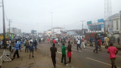 •Protesters on the streets of Ondo rampaging over INEC's recognition of Jimoh Ibrahim as the PDP guber candidate yesterday (inset) burnfire set by the protesters.
