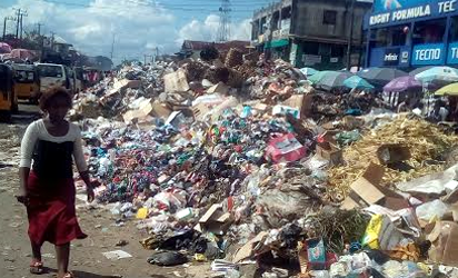 REFUSE—The refuse dump along Douglas Road, Owerri, Imo State.