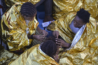 (FILES) This file photo taken on November 03, 2016 shows African women aboard the Topaz Responder ship run by Maltese NGO Moas and the Red Cross after a rescue operation of migrants and refugees on November 3, 2016, off the Libyan coast in the Mediterranean Sea. The arrive in their hundreds every month, their heads full of dreams of new lives in Europe. In reality, many of them are destined for years of sexual slavery. And in Italy's migrant-saturated southern ports, prising these young Nigerian girls away from their traffickers is a formidable challenge. / AFP PHOTO / ANDREAS SOLARO